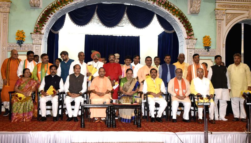 Lucknow: Uttar Pradesh Governor Anandiben Patel and Chief Minister Yogi Adityanath with the 23 newly sworn-in state cabinet ministers, at Raj Bhawan in Lucknow, on Aug 21, 2019. (Photo: IANS)