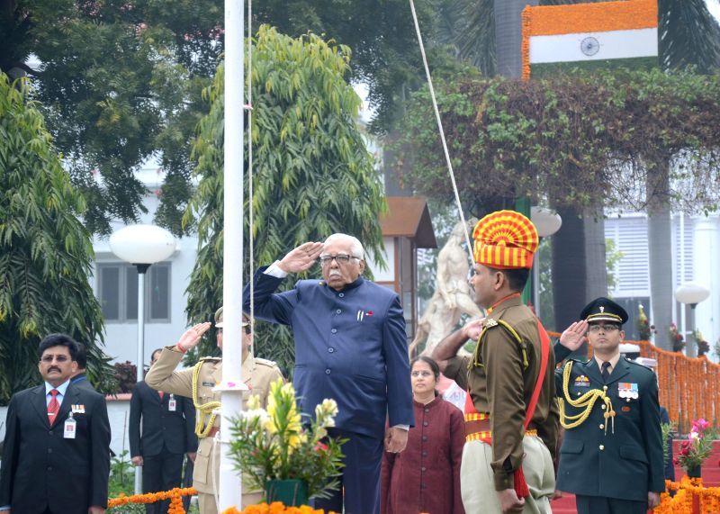 Uttar Pradesh Governor Ram Naik hoists the national flag during a programme organised to celebrate Republic Day in Lucknow on Jan 26, 2015.