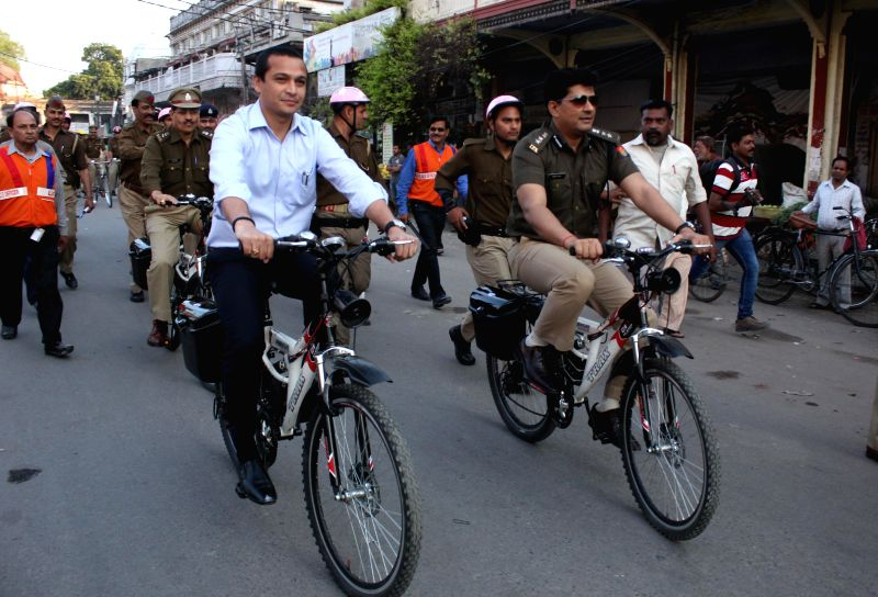 Uttar Pradesh officials cycle during a route march in Lucknow on March 17, 2015.