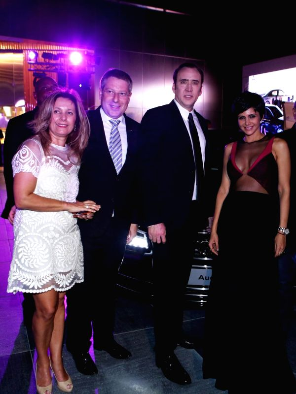 Lucy and Joe King, hollywood actor Nicholas Cage and Mandira Bedi during the launch of Audi A8L in Dubai. - Nicholas Cage