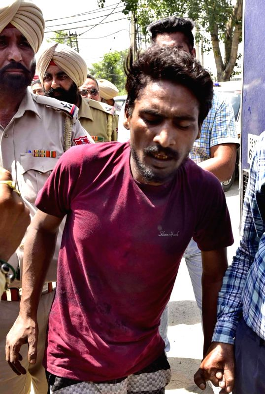 Ludhiana: Karamjit Singh, one of the jail inmates at the Ludhiana Central Jail who was caught fleeing during protests that broke out after at least 10 inmates of the jail sustained injuries in a clash between two groups, on June 27, 2019. The inciden