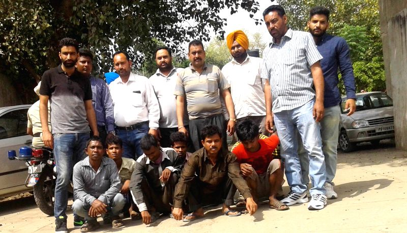 Punjab policemen present before press people held by them in connection with West Bengal nun gang-rape in Ludhiana, on April 3, 2015.