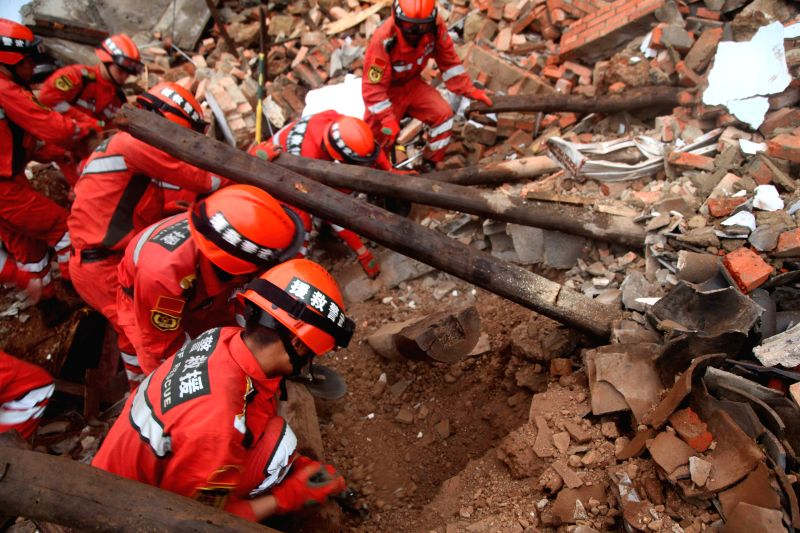 Rescuers search for missing people at quake-hit Longquan Village of Longtoushan Town in Ludian County, southwest China's Yunnan Province, Aug. 4, 2014. At least 381 ..