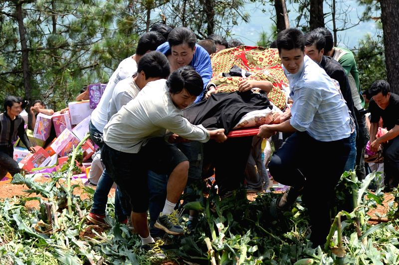 Villgers transfer an injured person in Longjing Village of Longtoushan Town in Ludian County, southwest China's Yunnan Province, Aug. 6, 2014. Death toll from a ...