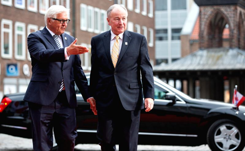 German Foreign Minister Frank-Walter Steinmeier (L) welcomes Canadian Foreign Minister Robert Nicholson ahead of the meeting of the G7 Foreign Ministers in ... - Frank-Walter Steinmeier