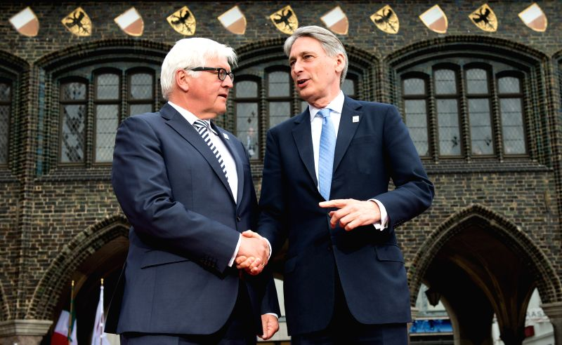 German Foreign Minister Frank-Walter Steinmeier (L) welcomes British Foreign Secretary Philip Hammond ahead of the meeting of the G7 Foreign Ministers in Luebeck, ... - Frank-Walter Steinmeier