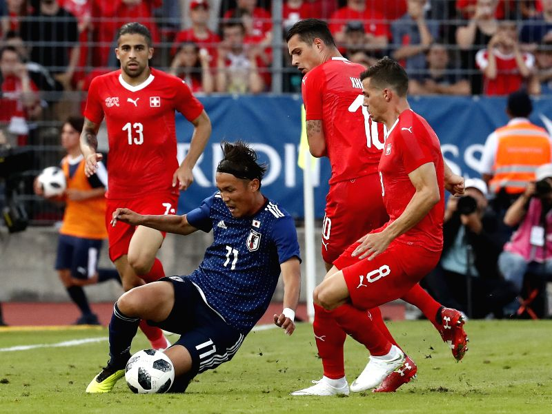 LUGANO, June 9, 2018 - Japan's Takashi Usami (2nd L) vies for the ball during the international friendly match against Switzerland at the Stadium Cornaredo in Lugano, southern Switzerland June 8, ...