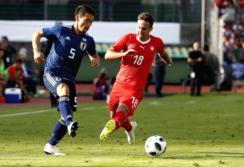 LUGANO, June 9, 2018 - Switzerland's Mario Gavranovic (R) vies with Japan's Yuko Nagatomo during the international friendly match at the Stadium Cornaredo in Lugano, southern Switzerland June 8, ...