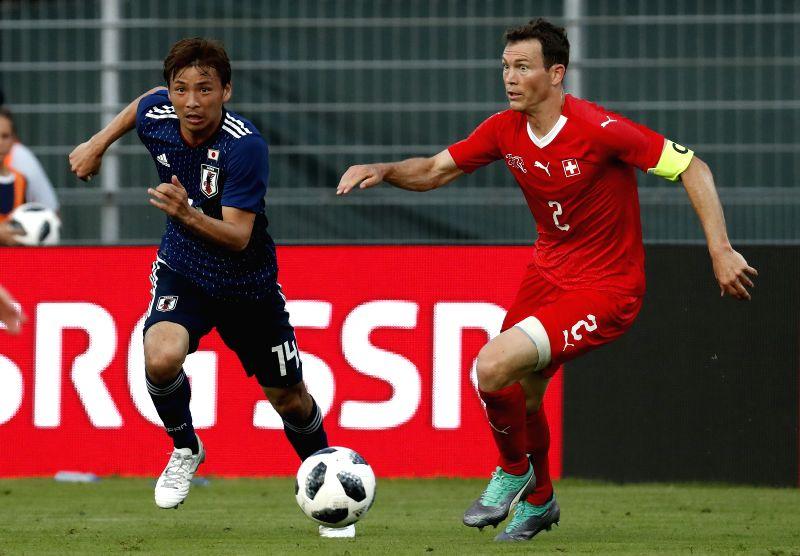 LUGANO, June 9, 2018 - Switzerland's Stephan Lichtsteiner (R) vies with Japan's Takashi Inui during the international friendly match at the Stadium Cornaredo in Lugano, southern Switzerland June 8, ...