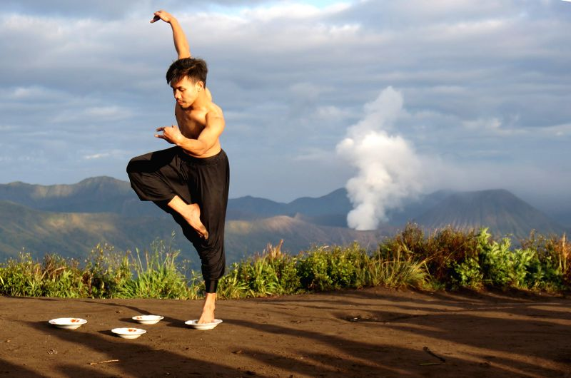 """LUMAJANG, May 7, 2017 - A dancer performs a contemporary dance with theme """"Dance in The Sky"""" in Lumajang, East Java, Indonesia on May 7, 2017."""