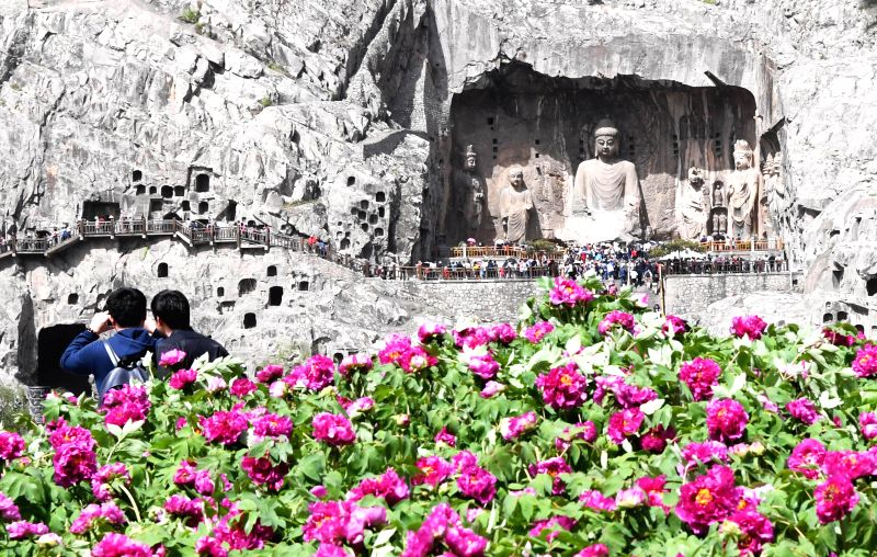 LUOYANG, April 19, 2017 - Tourists visit the Longmen Grottoes in Luoyang, central China's Henan Province, April 17, 2017. The Longmen Grottoes has entered into tourist rush season.