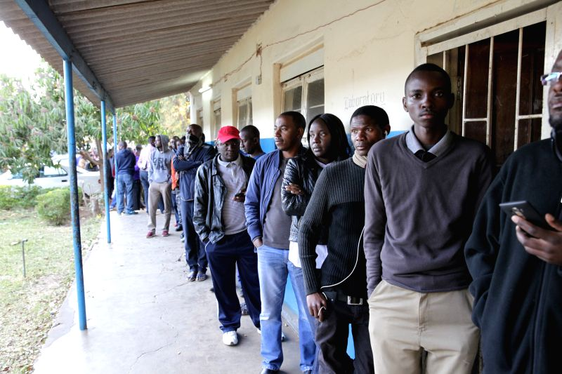 LUSAKA, Aug. 11, 2016 - Voters wait to cast their ballots at a polling station in Lusaka, capital of Zambia, on Aug. 11, 2016. Polling started Thursday morning for Zambia' s general elections and ...