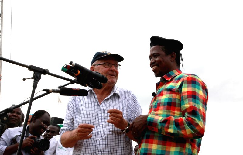 Zambian ruling Patriotic Front presidential candidate, Defense and Justice Minister Edgar Lungu (R) talks with interim president Guy Scott during a rally at the ... - Edgar Lungu