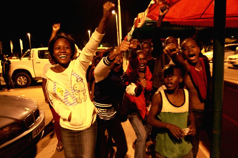 Supporters of Zambia's ruling Patriotic Front (PF) party celebrate victory in Lusaka, capital of Zambia, Jan. 24, 2015. PF presidential candidate Edgar Lungu has won
