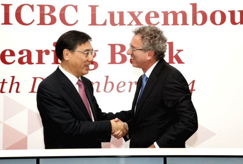 Minister for Finances of Luxembourg Pierre Gramegna (R) and President of ICBC Jiang Jianqing shake hands at the launching ceremony of ICBC Luxembourg Branch as RMB clearing bank in ...
