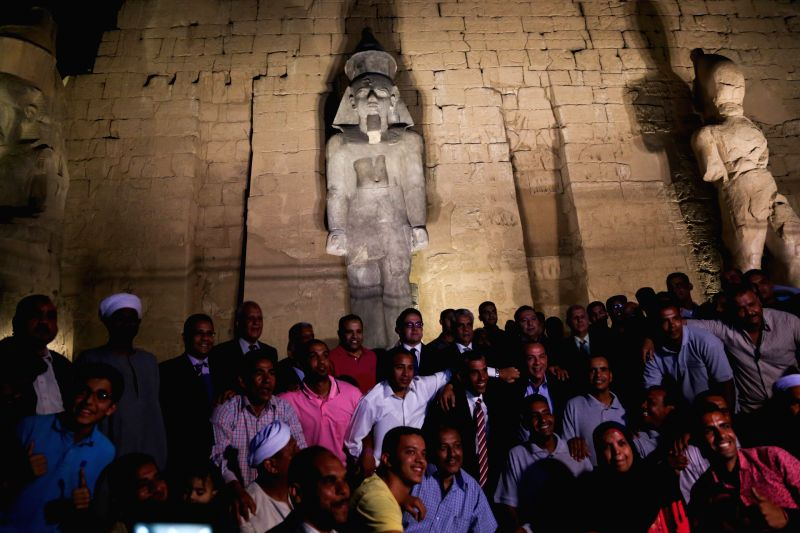 LUXOR, April 19, 2017 - People pose for a group photo in front of a newly restored colossus statue of king Ramses II at the Luxor Temple in Luxor, Egypt on April 18, 2017. Egypt's Ministry of ...