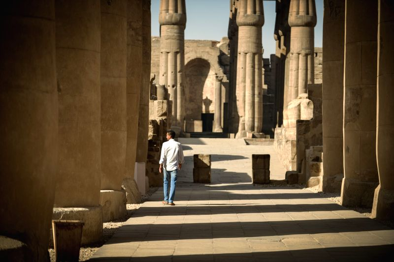 A man walks in the Luxor Temple in Luxor, a tourist resort in south Egypt, on April 30, 2014.