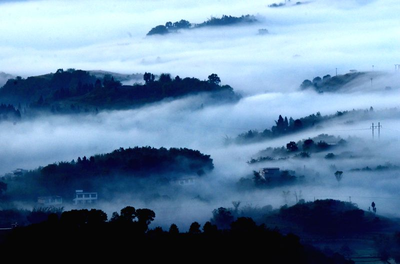 Photo taken on May 1, 2014 shows a view of morning fog over Hejiang County in Luzhou, southwest China's Sichuan province.  (Photo : Xinhua/Du Yong/IANS)