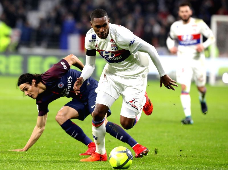 LYON, Jan. 22, 2018 - Marcelo (R) of Lyon competes with Edinson Cavani from Paris Saint-Germain during the match between Paris Saint-Germain and Lyon of French Ligue 1 2017-2018 season 22nd round in ...