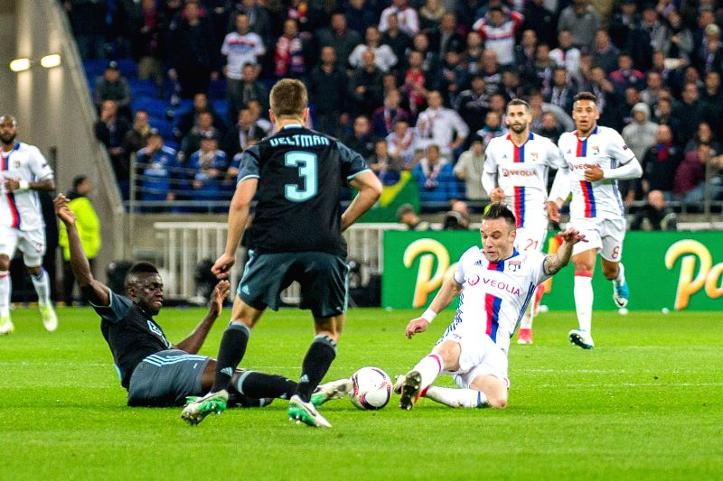 LYON, May 12, 2017 - Mathieu Valbuena (R) from Lyon competes with Davinson Sanchez (L) from Ajax during the second leg of the Europa League semifinal in Lyon, France on May 11, 2017. Despite the ...