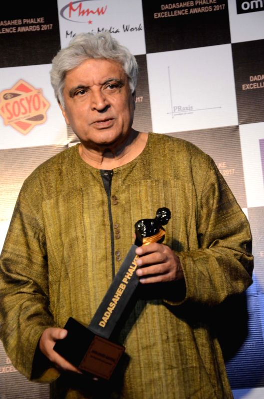 "Lyricist Javed Akhtar with the Dadasaheb Phalke award trophy in Mumbai on April 21, 2017. Javed Akhtar was given Dada Saheb Phalke award for ""Best Poet, lyricist and Script writer"" ... - Javed Akhtar"