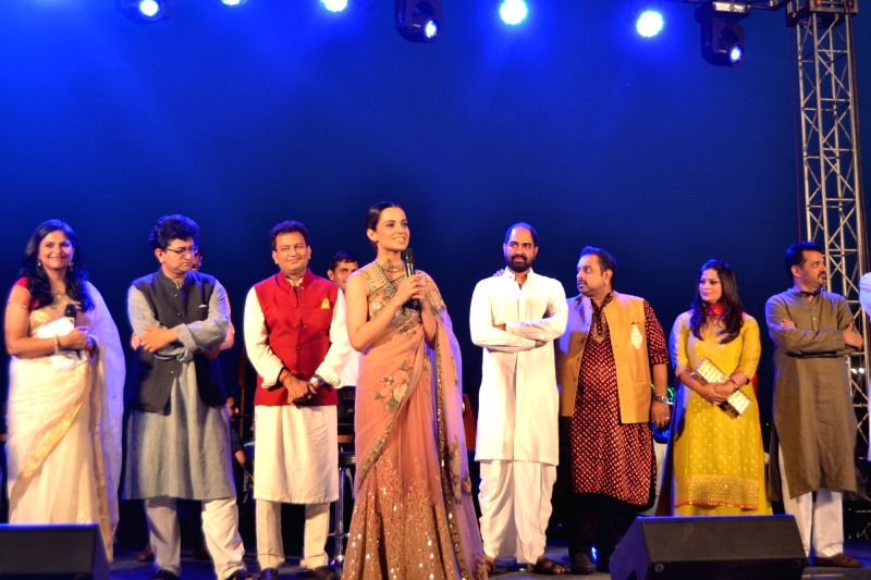 "Lyricist Prasoon Joshi and actress Kangana Ranaut with singers Shankar Mahadevan and Ehsaan Noorani at the poster launch of upcoming film ""Manikarnika: The Queen of Jhansi"" in ... - Kangana Ranaut and Prasoon Joshi"