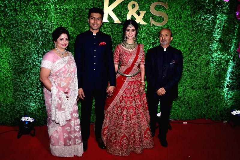 Lyricist Sameer Anjaan and his wife Anita Pandey with their daughter Suchita at her wedding reception in Mumbai, on Jan 23, 2019. - Anita Pandey