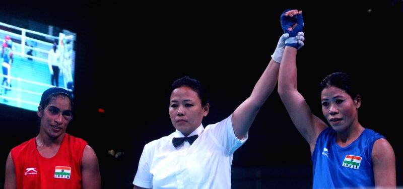 M C Mary Kom (Blue) of India after winning against comaptriate Choudhary Varsha (Red) during the 1st India Open international boxing tournament in New Delhi, on Jan 28, 2018. - Mary Kom