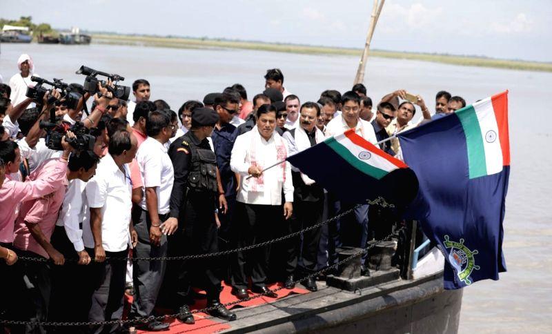 Mājuli: Assam Chief Minister Sarbananda Sonowal flags off ferry services, at Kamalabari ferry ghat in Mājuli, Assam on Aug 9, 2018. - Sarbananda Sonowal