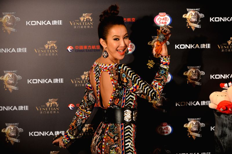 Singer Coco Lee attends the 18th China Music Awards (CMA) and Asian Influential Awards ceremony in Macao, south China, April 23, 2014.
