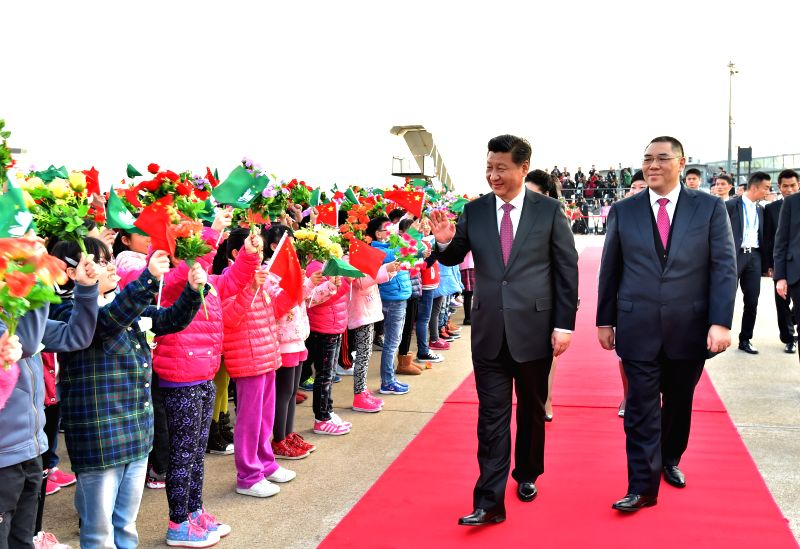 Chinese President Xi Jinping waves to people at the airport in Macao, south China, on Dec. 20, 2014. Xi ended his two-day visit to Macao on Saturday after attending ..