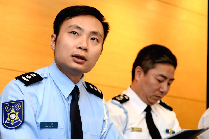 Lam Keong (L), an officer of Macao's Public Security Police Force, speaks during a press conference in Macao, south China, Feb. 27, 2015. A ferry carrying 19 people ...