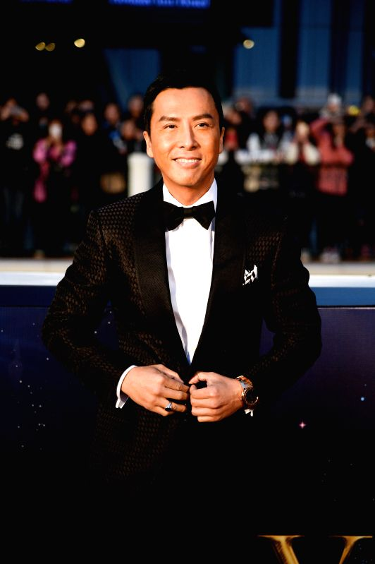 Actor Donnie Yen arrives on the red carpet for the 15th Huading Awards, the release ceremony of the Global Entertainment Celebrities Satisfaction Survey, in Macao, ... - Donnie Yen
