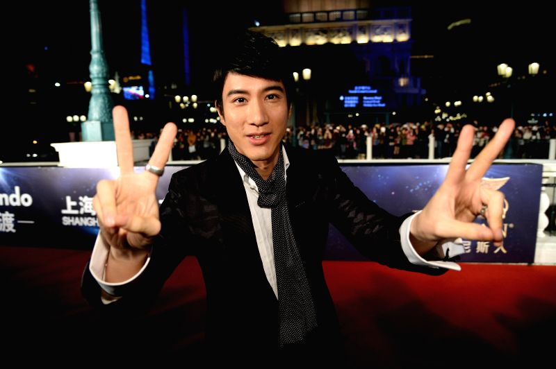 Actor Leehom Wang arrives on the red carpet for the 15th Huading Awards, the release ceremony of the Global Entertainment Celebrities Satisfaction Survey, in Macao, .. - Leehom Wang