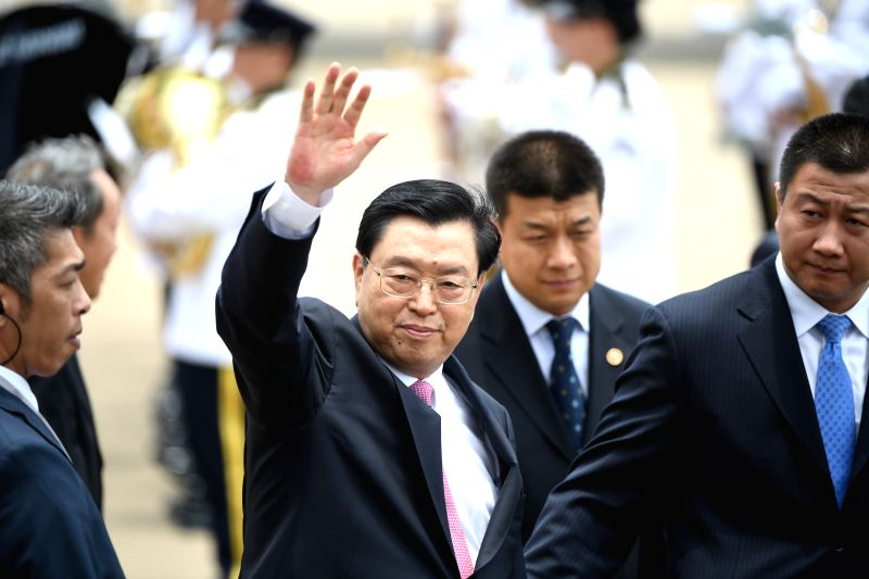 MACAO, May 8, 2017 - Zhang Dejiang, chairman of the Standing Committee of China's National People's Congress (NPC), arrives at the Macao International Airport, in Macao, south China, May 8, 2017. ...