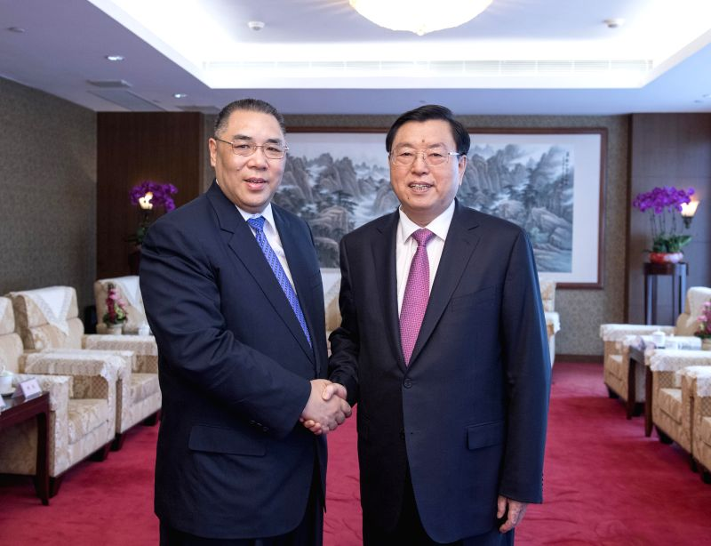 MACAO, May 8, 2017 - Zhang Dejiang (R), chairman of the Standing Committee of China's National People's Congress (NPC), meets with Chui Sai On, chief executive of the Macao Special Administrative ...