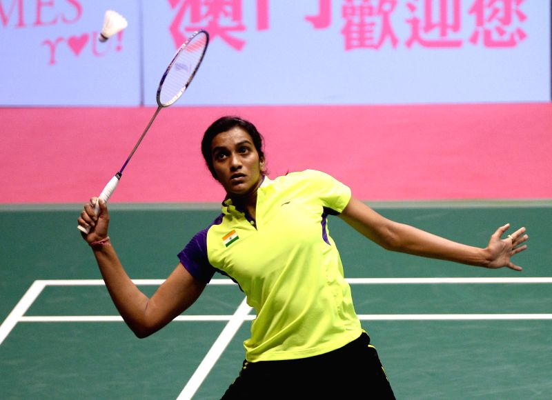 Indian badminton player P V Sindhu in action against Thailand Busanan Ongbumrungpan during the women`s singles match of 2014 Macau Grand Prix Gold in Macau, China on Nov 29, 2014. Sindhu won ..