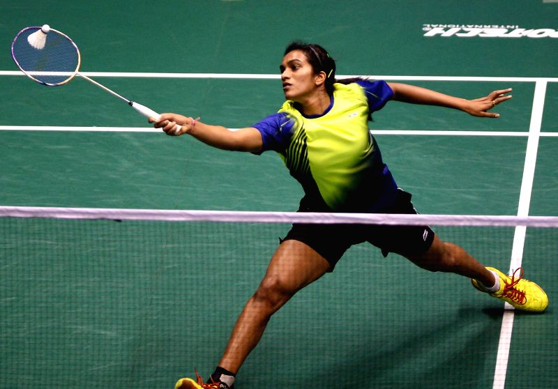 Indian badminton player P V Sindhu in action against South Korean Kim Hyo Min during the women's singles final match of 2014 Macau Grand Prix Gold in Macau, China on Nov 30, 2014. Sindhu won.
