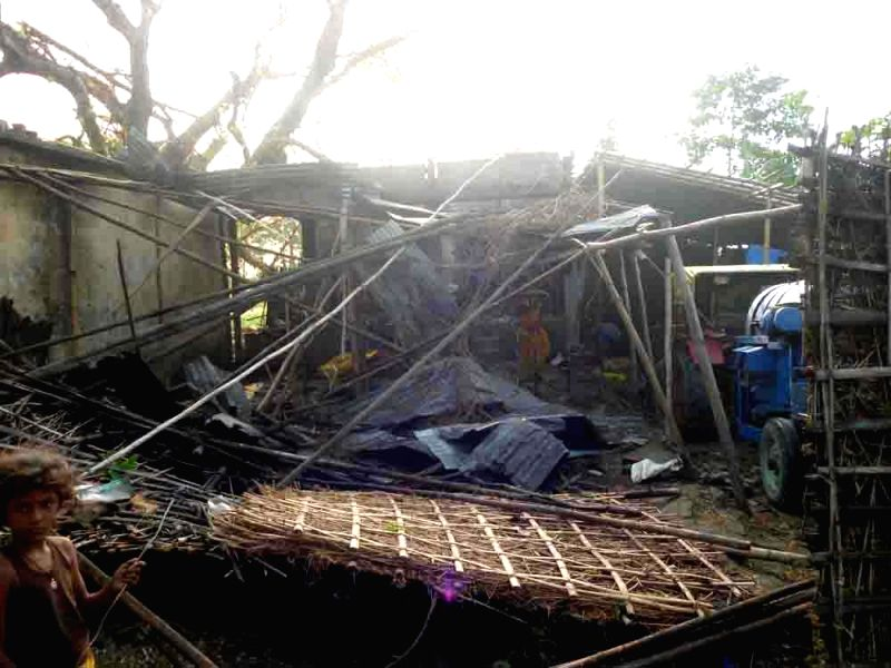 Houses destroyed  in a storm that lashed Purnia, Madhepura and several other districts of Bihar late on Tuesday night (22nd April 2015) mourn his death on April 22, 2015. At least 32 ...