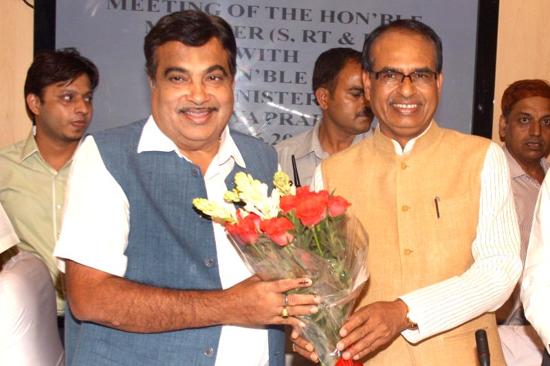 Madhya Pradesh Chief Minister Shivraj Singh Chouhan with Union Minister for Shipping, and Road Transport and Highways Nitin Gadkari during a meeting in New Delhi on June 24, 2014. - Shivraj Singh Chouhan