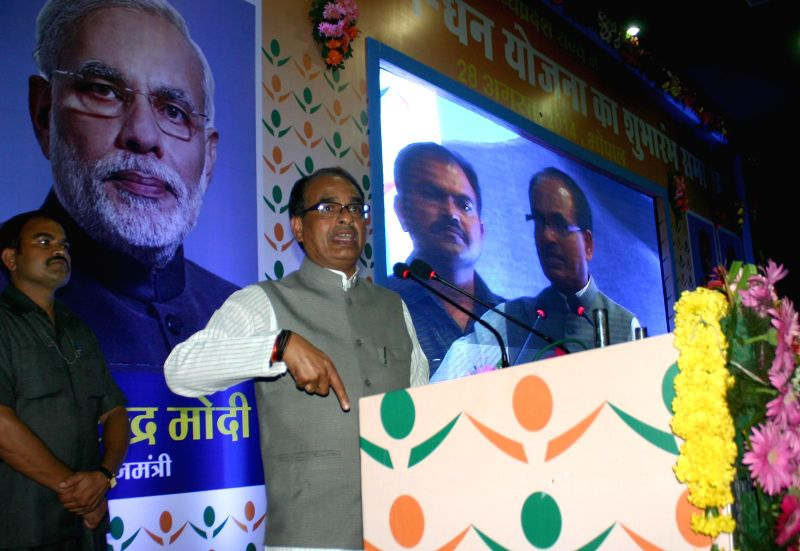Madhya Pradesh Chief Minister Shivraj Singh Chouhan addresses at the inaugural function of Prime Minister Jan-Dhan Abhiyan in Bhopal on Aug 28, 2014. - Shivraj Singh Chouhan