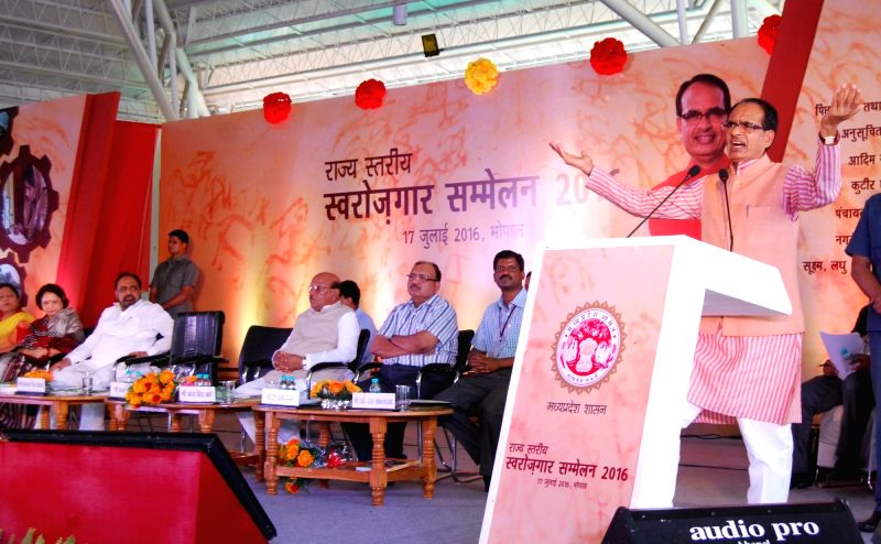 Madhya Pradesh Chief Minister Shivraj Singh Chouhan addresses during a Swarojgar Sammelan in Bhopal on July 17, 2016. - Shivraj Singh Chouhan