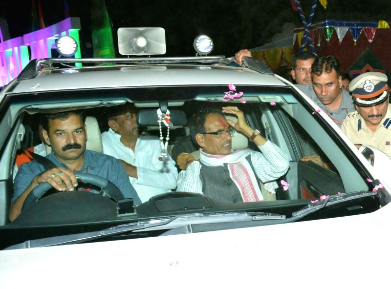Madhya Pradesh Chief Minister Shivraj Singh Chouhan removes beacon from his car in Bhopal, on April 19, 2017. In an effort to do away with VIP culture in India, the government on Wednesday ... - Shivraj Singh Chouhan