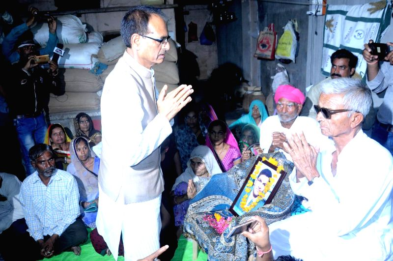 Madhya Pradesh Chief Minister Shivraj Singh Chouhan meets the family members of six farmers, who were allegedly killed in police firing, and handed over Rs 1 crore each as aid to the kin of ... - Shivraj Singh Chouhan