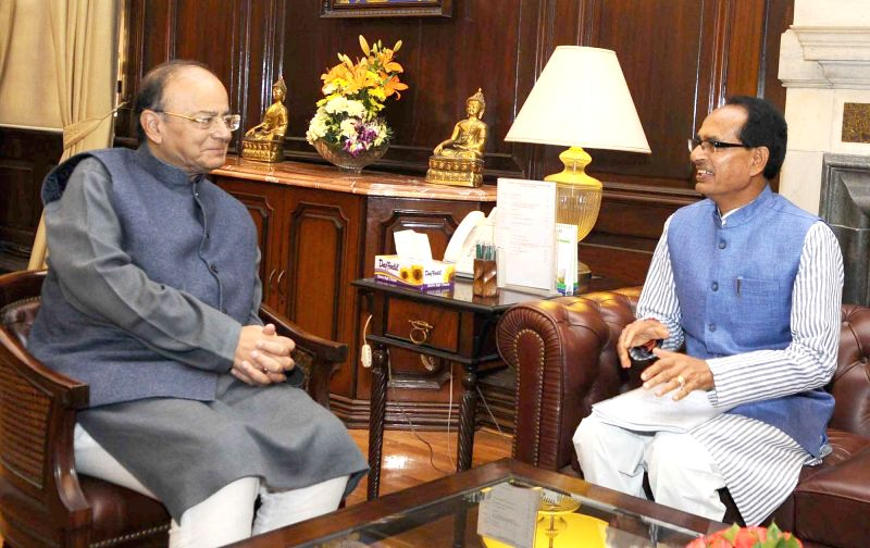 Madhya Pradesh Chief Minister Shivraj Singh Chouhan calls on the Union Minister for Finance and Corporate Affairs Arun Jaitley in New Delhi on Feb 13, 2018. - Shivraj Singh Chouhan and Affairs Arun Jaitley