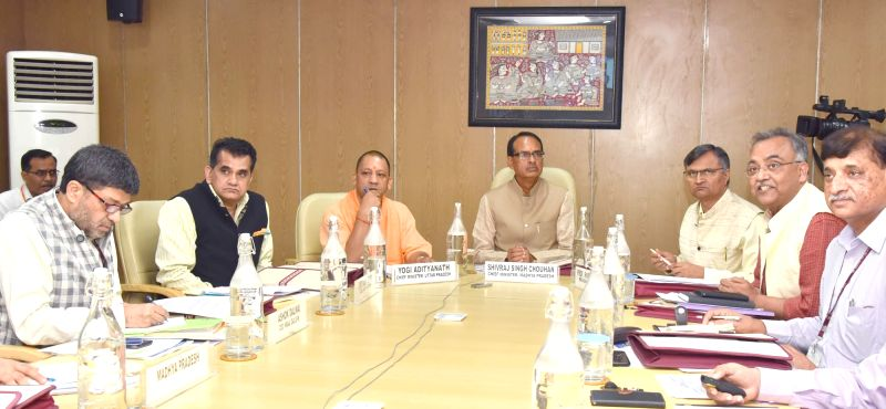 Madhya Pradesh Chief Minister Shivraj Singh Chouhan, Uttar Pradesh Chief Minister Yogi Adityanath and NITI Aayog CEO Amitabh Kant at the First Meeting of CM's Subgroup on Convergence of ... - Shivraj Singh Chouhan