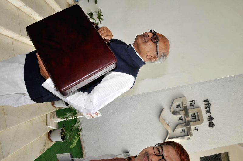 Madhya Pradesh Finance Minister Jayant Malaiya arrives to present the annual budget in Madhya Pradesh Legislative Assembly in Bhopal on July 1, 2014.