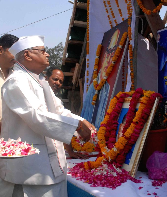 Madhya Pradesh Governor Ram Naresh Yadav pays tribute to Dr. BR Ambedkar on his birth anniversary in Bhopal on April 14, 2014.