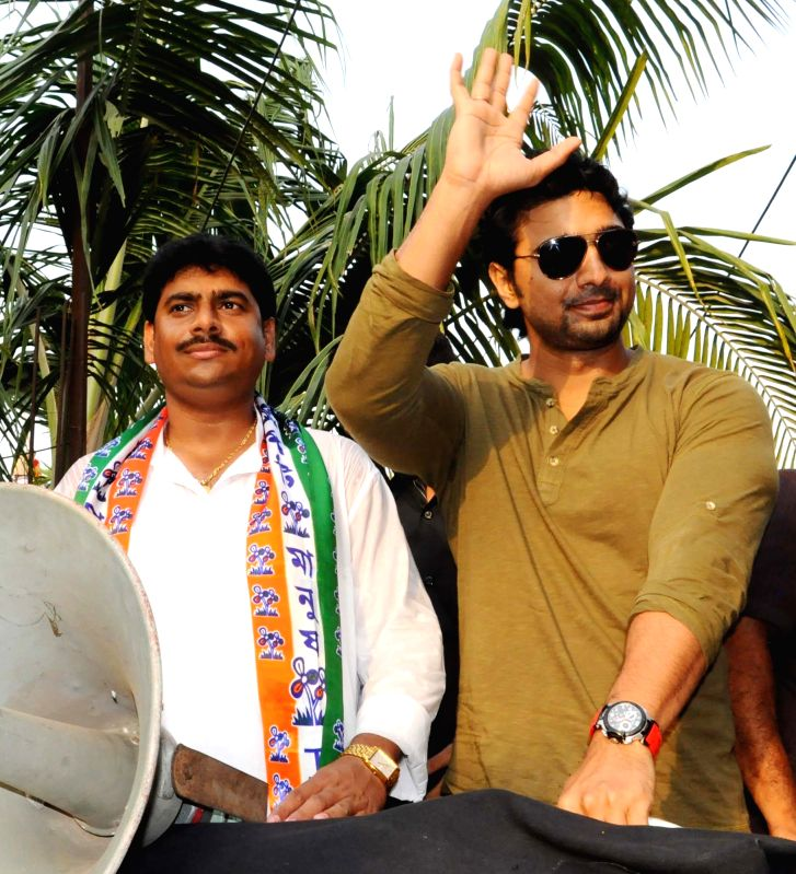 Actor and Trinamool Congress  MP Dev campaigns for the party ahead of Madhyamgram Municipality polls in West Bengal's North 24 Parganas district on April 21, 2015.