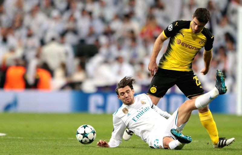 MADRID, Dec. 7, 2017 - Mateo Kovacic(down) of Real Madrid competes during the UEFA Champions League group H football match between Real Madrid CF and Borussia Dortmund at the Santiago Bernabeu ...